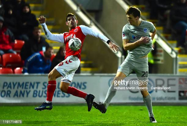 FLEETWOOD ENGLAND JANUARY Fleetwood Town's Ched Evans vies for possession with Portsmouth's Sean Raggett during the FA Cup Third Round match between...