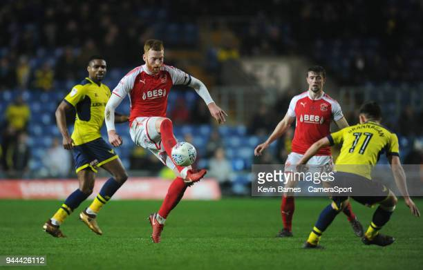 Fleetwood Town's Cian Bolger under pressure from Oxford United's Cameron Brannagan during the Sky Bet League One match between Oxford United and...