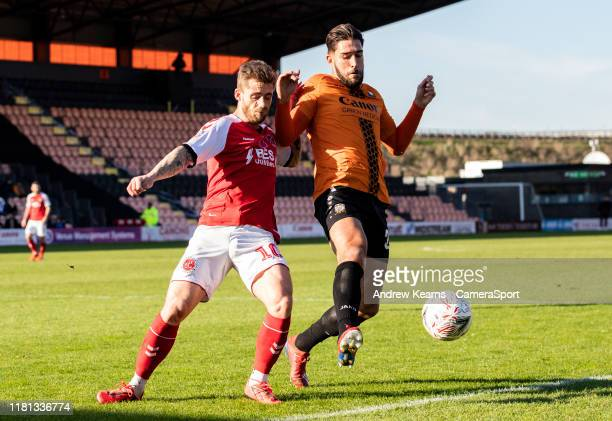 Fleetwood Town's Conor McAleny competing with Barnet's Dan Sweeney during the FA Cup First Round match between Barnet and Fleetwood Town at The Hive...
