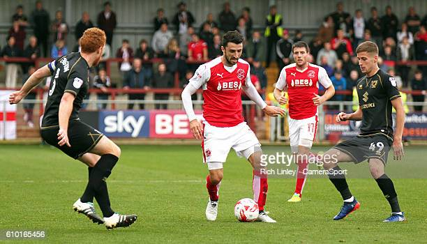 Fleetwood Town's Conor McLaughlin under pressure from Milton Keynes Dons' Dean Lewington and Ryan Colclough during the Sky Bet League One match...