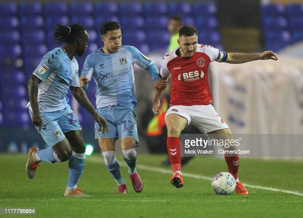 Fleetwood Town's Danny Andrew in action with Coventry City's Fankaty Dabo during the Sky Bet League One match between Coventry City and Fleetwood...