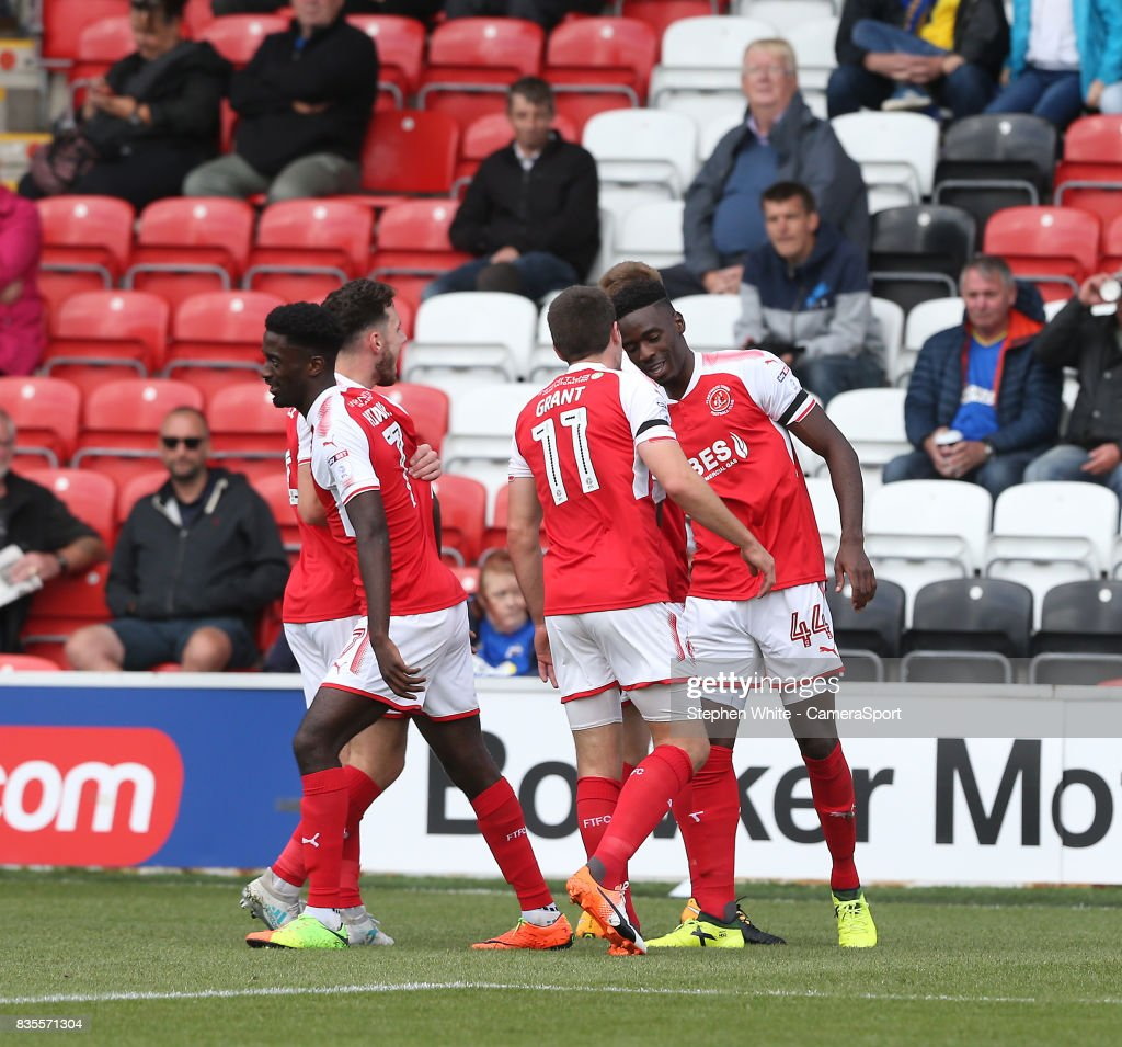 Fleetwood Town's Devante Cole celebrates scoring his and his side's second goal with team-mate Bobby Grant during the Sky Bet League One match between Fleetwood Town and A.F.C. Wimbledon at Highbury Stadium on August 19, 2017 in Fleetwood, England.