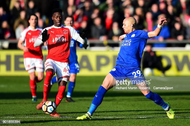 Fleetwood Town's Devante Cole competes with Leicester City's Yohan Benalouane during the Emirates FA Cup Third Round match between Fleetwood Town and...