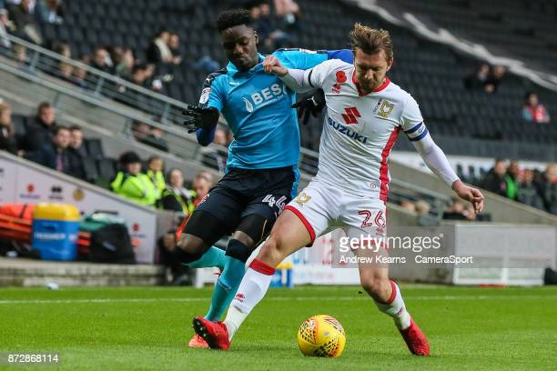 Fleetwood Town's Devante Cole competing with Milton Keynes Dons' Alex Gilbey during the Sky Bet League One match between Milton Keynes Dons and...