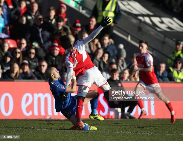 Fleetwood Town's Devante Cole is pulled to the ground by Leicester City's Yohan Benalouane during the Emirates FA Cup Third Round match between...