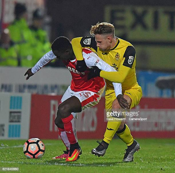 Fleetwood Town's Elohor Godswill Ekpolo battles with Southport's James Caton during the The Emirates FA Cup First Round match between Southport and...