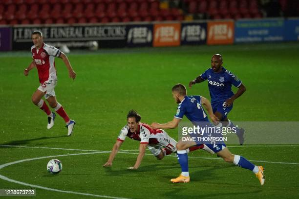 Fleetwood Town's English midfielder Josh Morris is tackled during the English League Cup third round football match between Fleetwood Town and...