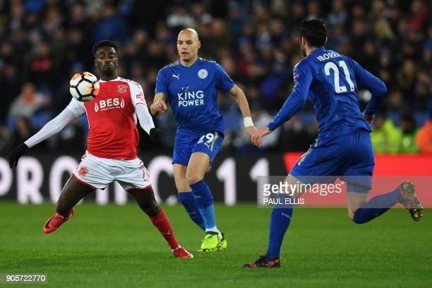 Fleetwood Town's English striker Jordy Hiwula vies with Leicester City's French defender Yohan Benalouane and Leicester City's Spanish midfielder...