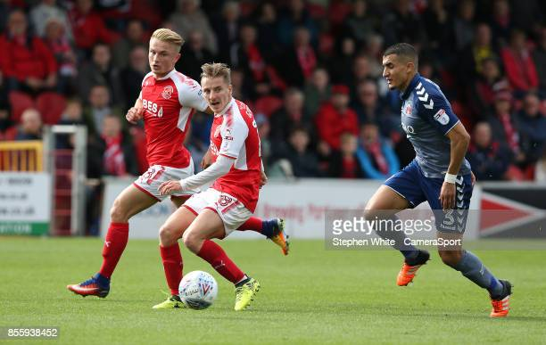 Fleetwood Town's George Glendon is watched by Charlton Athletic's Ahmed Kashi during the Sky Bet League One match between Fleetwood Town and Charlton...