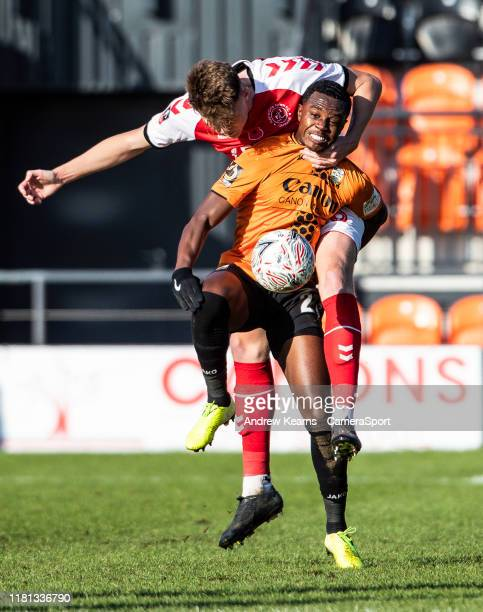 Fleetwood Town's Harry Souttar competing with Barnet's Cheye Alexander during the FA Cup First Round match between Barnet and Fleetwood Town at The...