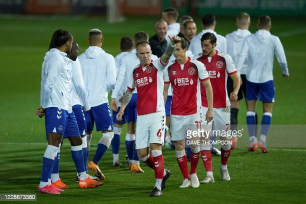 Fleetwood Town's Irish midfielder Glenn Whelan gestures as they players walk onto the field during the English League Cup third round football match...