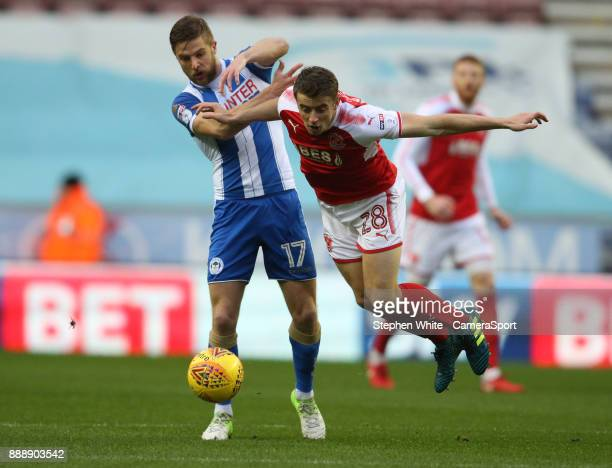 Fleetwood Town's Jack Sowerby and Wigan Athletic's Michael Jacobs during the Sky Bet League One match between Wigan Athletic and Fleetwood Town at DW...