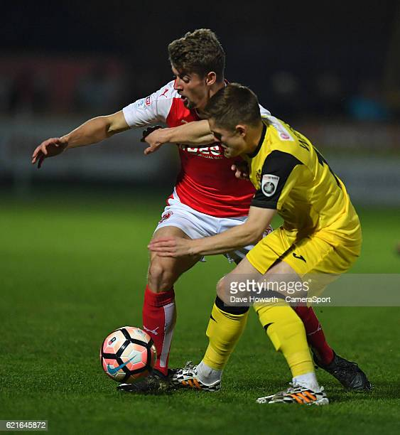 Fleetwood Town's Jack Sowerby battles with Southport's Declan Weeks during the The Emirates FA Cup First Round match between Southport and Fleetwood...