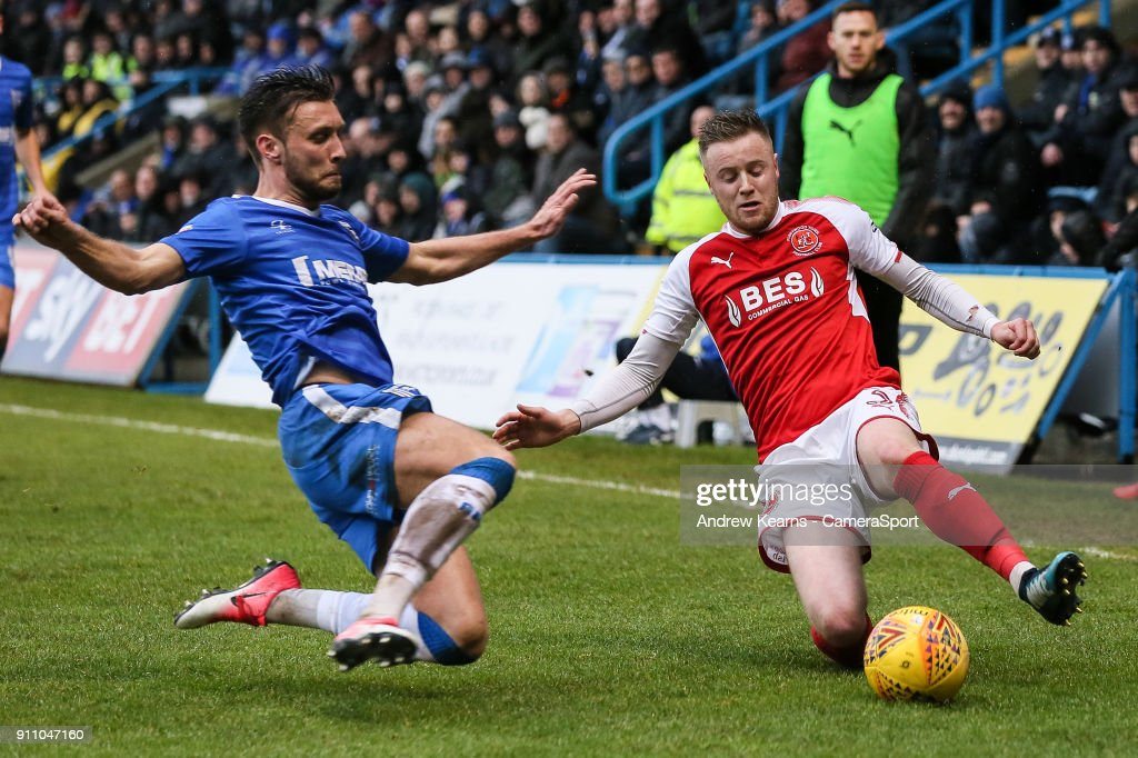 Fleetwood Town's Kevin O'Connor competing with Gillingham's Luke O'Neill during the Sky Bet League One match between Gillingham and Fleetwood Town at Priestfield Stadium on January 27, 2018 in Gillingham, .