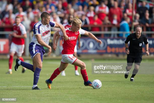 Fleetwood Town's Kyle Dempsey battles with Rotherham United's Jamie Proctor during the Sky Bet League One match between Fleetwood Town and Rotherham...