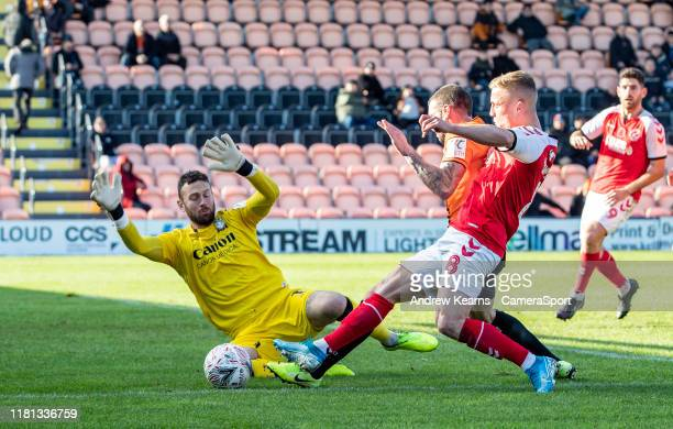 Fleetwood Town's Kyle Dempsey competing with Barnet's goalkeeper Scott Loach during the FA Cup First Round match between Barnet and Fleetwood Town at...