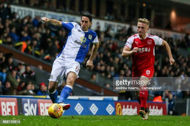 Fleetwood Town's Kyle Dempsey is beaten to the ball by Blackburn Rovers' Peter Whittingham during the Sky Bet League One match between Blackburn...