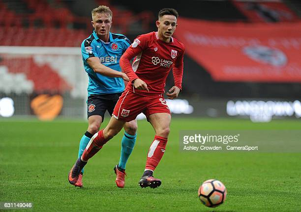 Fleetwood Town's Kyle Dempsey vies for possession with Bristol City's Josh Brownhill during the Emirates FA Cup Third Round match between Bristol...