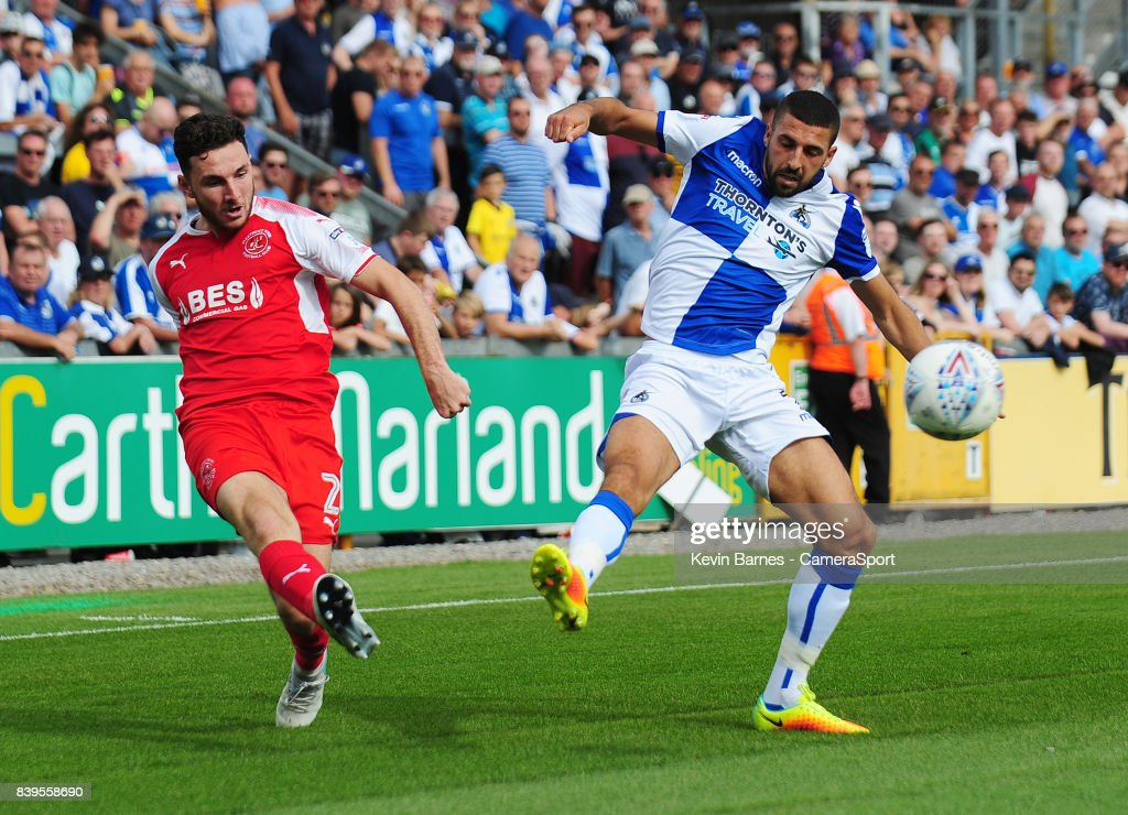 Fleetwood Town's Lewis Coyle crosses despite the attentions of Bristol Rovers' Liam Sercombe during the Sky Bet League One match between Bristol Rovers and Fleetwood Town at Memorial Stadium on August 26, 2017 in Bristol, England.