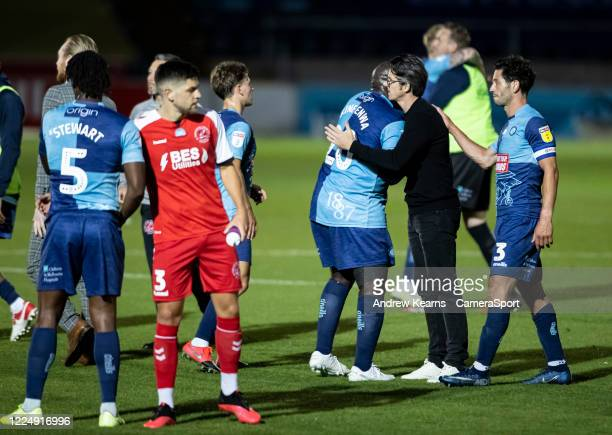 Fleetwood Town's manager Joey Barton congratulates Wycombe Wanderers' Adebayo Akinfenwa at the end of the match during the Sky Bet League One Play...