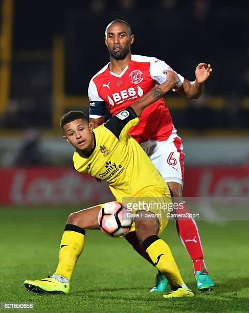 Fleetwood Town's Nathan Pond battles with Southport's Jamie Allen during the The Emirates FA Cup First Round match between Southport and Fleetwood...