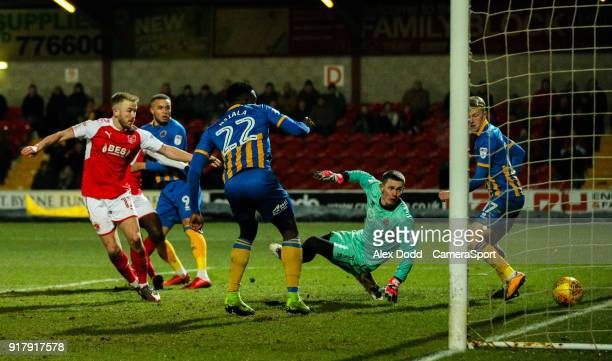 Fleetwood Town's Paddy Madden beats Shrewsbury Town's Dean Henderson to make the score 11 during the Sky Bet League One match between Fleetwood Town...