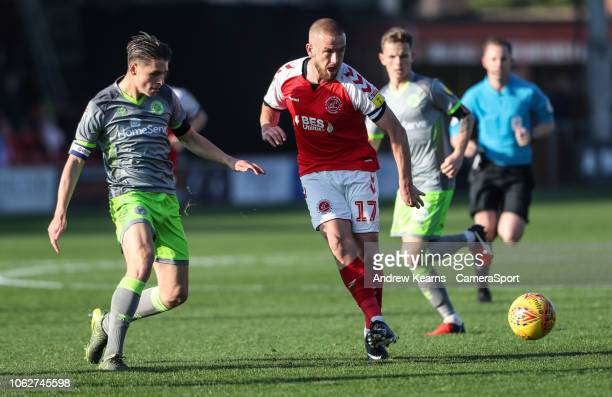 Fleetwood Town's Paddy Madden competing with Walsall's George Dobson during the Sky Bet League One match between Fleetwood Town and Walsall at...