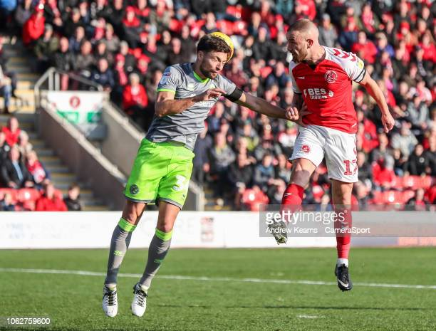 Fleetwood Town's Paddy Madden heads at goal under pressure from Walsall's Russell Martin during the Sky Bet League One match between Fleetwood Town...