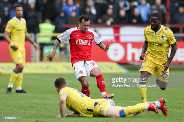 Fleetwood Town's Ross Wallace competing with Bristol Rovers' James Clarke and Abu Ogogo during the Sky Bet League One match between Fleetwood Town...
