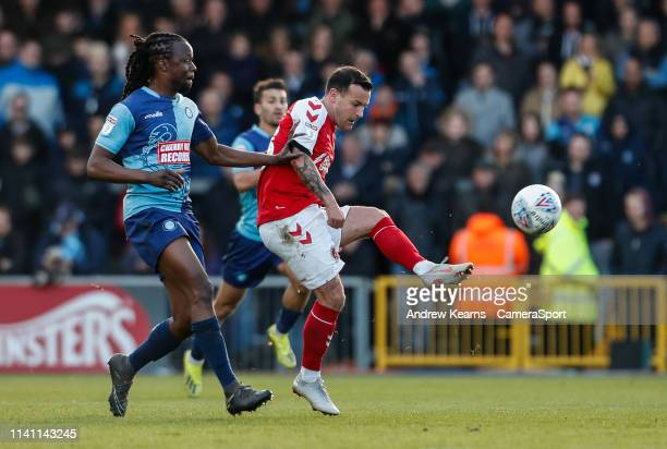 Fleetwood Town's Ross Wallace competing with Wycombe Wanderers' Marcus Bean during the Sky Bet League One match between Wycombe Wanderers and...