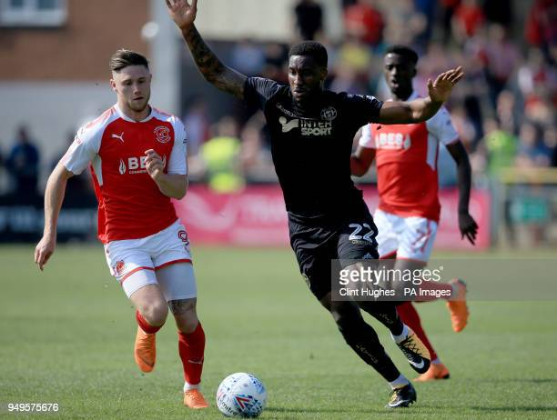 Fleetwood Town's Wes Burns and Wigan Athletic's Cheyenne Dunkley battle for the ball during the Sky Bet League One match at Highbury Stadium Fleetwood