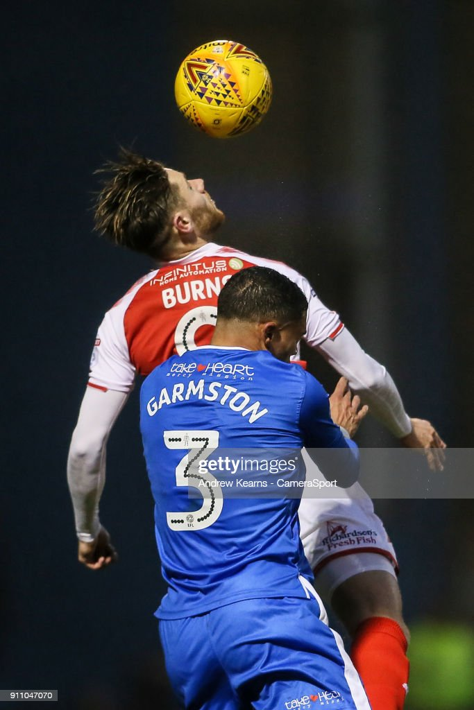 Fleetwood Town's Wes Burns competing in the air with Gillingham's Bradley Garmston during the Sky Bet League One match between Gillingham and Fleetwood Town at Priestfield Stadium on January 27, 2018 in Gillingham, .