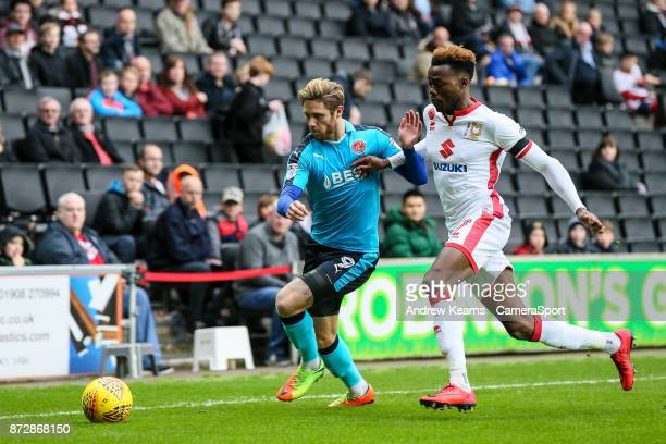 Fleetwood Town's Wes Burns competing with Milton Keynes Dons' Gboly Ariyibi during the Sky Bet League One match between Milton Keynes Dons and...