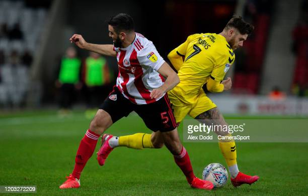 Fleetwood Town's Wes Burns is tackled by Sunderland's Alim Ozturk during the Sky Bet Leauge One match between Sunderland and Fleetwood Town at...
