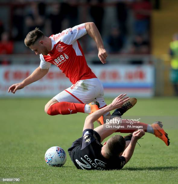 Fleetwood Town's Wes Burns is tackled by Wigan Athletic's Ryan Colclough during the Sky Bet League One match at Highbury Stadium Fleetwood