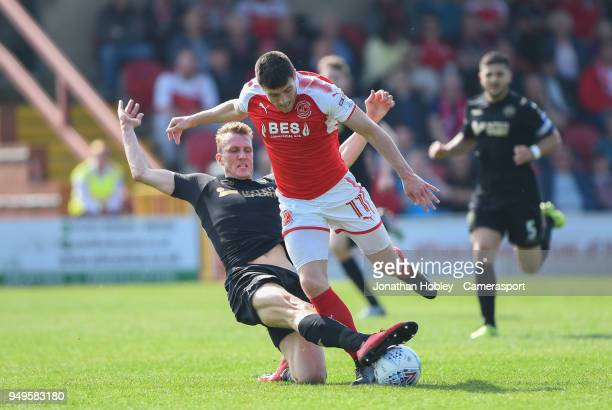 Fleetwood's Bobby Grant is tackled by Wigan'se Dan Burn during the Sky Bet League One match between Fleetwood Town and Wigan Athletic at Highbury...