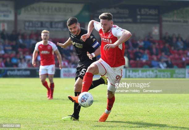 Fleetwood's Wes Burns battles with Wigan's Sam Morsy during the Sky Bet League One match between Fleetwood Town and Wigan Athletic at Highbury...