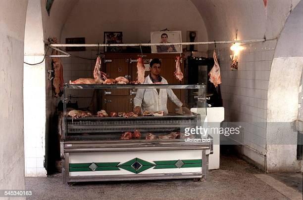 Fleischerei Im Laden hängt einPorträt von Präsident Ben Ali 1998