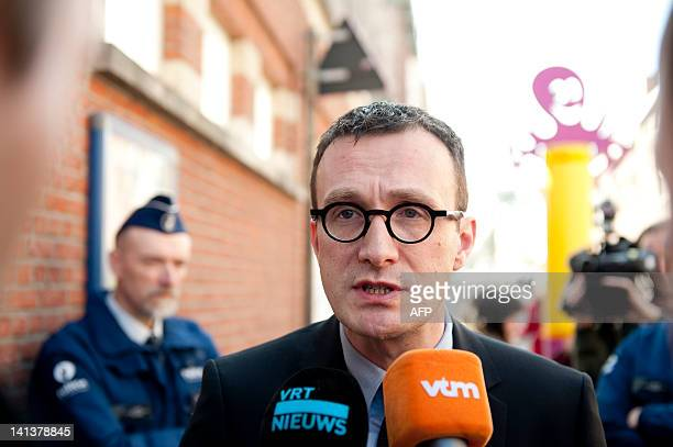 Flemish ministre of culture Pascal Smet talks to the press in front of the entrance of the primary school SintLambertusschool in Heverlee on March 15...