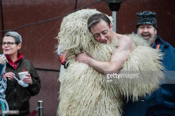 Flemish nationalists N-VA party chairman and Mayor of Antwerp Bart De Wever hugs the polar bear mascot during the polar bear New Year's dive in the...