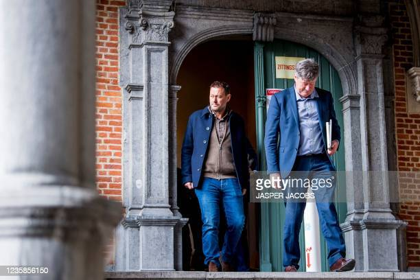 Flemish television producer Bart De Pauw and his lawyer Michael Verhaeghe exit the Criminal Court in Mechelen during his trial, accused of allegedly...