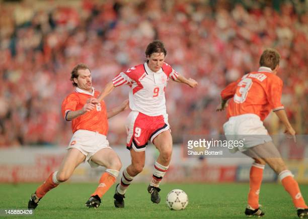Flemming Povlsen of Denmark takes the ball past Jan Wouters of Netherlands during the UEFA European Championships 1992 Semi-Final between Netherlands...