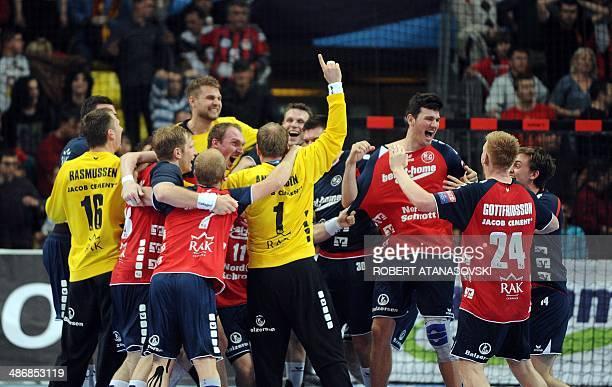 FlensburgHandewitt players celebrate their victory at the end of the EHF Champions League handball quarter final match between HC Vardar Skopje and...