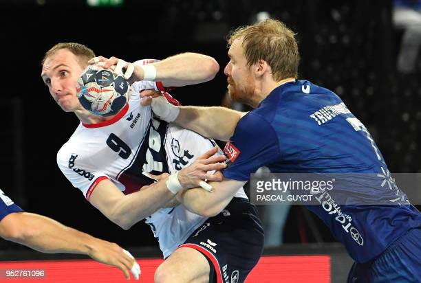 Flensburg's German right back Holger Glandorf vies with Montpellier's Lithuanian left back Jonas Truchanovicius during the EHF Champions League...