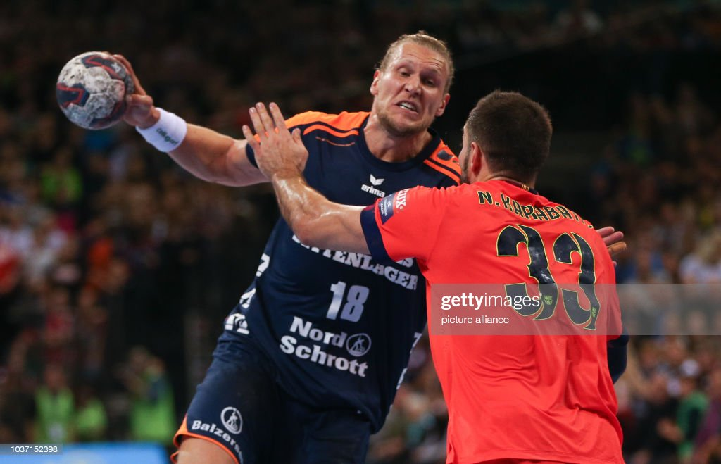 be4de671288 Flensburg s Lars Kaufmann (L) and Barcelona s Nikola Karabatic vie for the  ball during the