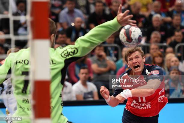 Flensburg's Lasse Svan scores against Kiel's goalkeeper Andreas Palicka during the Champions League EHF Final Four final handball match between THW...