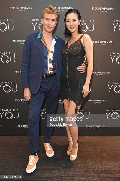 Fletcher Cowan and Betty Bachz attend the Emporio Armani Fragrance 'Stronger With You' party at Roast on July 18 2018 in London England