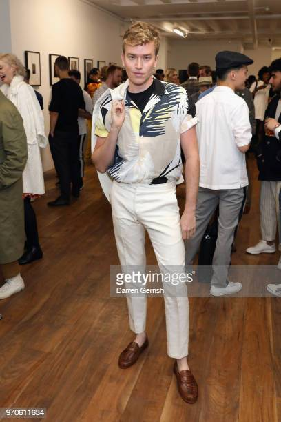Fletcher Cowan attends as Vogue Hommes Presents GarconJon 10 Years Of Street Style at 13 Floral Street on June 9 2018 in London England