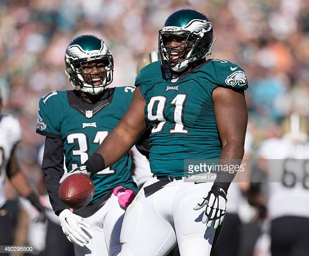Fletcher Cox and Byron Maxwell of the Philadelphia Eagles react after Cox forced and recovered a fumble in the third quarter against the New Orleans...