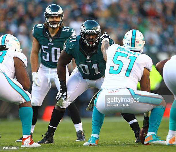 Fletcher Cox and Kiko Alonso of the Philadelphia Eagles line up against Mike Pouncey of the Miami Dolphins during a football game at Lincoln...